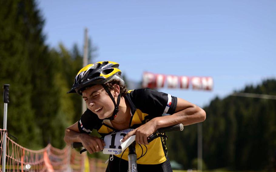 Alex Denikiewicz, 16, finally catches his breath Saturday after he won his age group in the 6-kilometer cross country race in Garmisch, Germany, then later completed the 25-kilometer mountain bike event.
