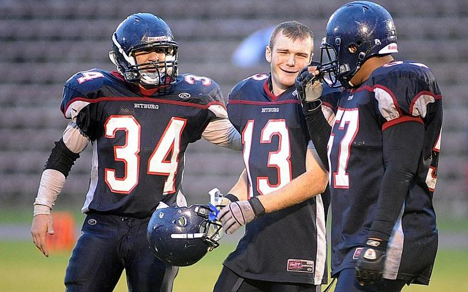 Austin Schmidt, Kyle Edgar and Darian Billups , from left, celebrate last season's  Division II title after defeating Mannheim. The trio will return for the Barons in 2011.