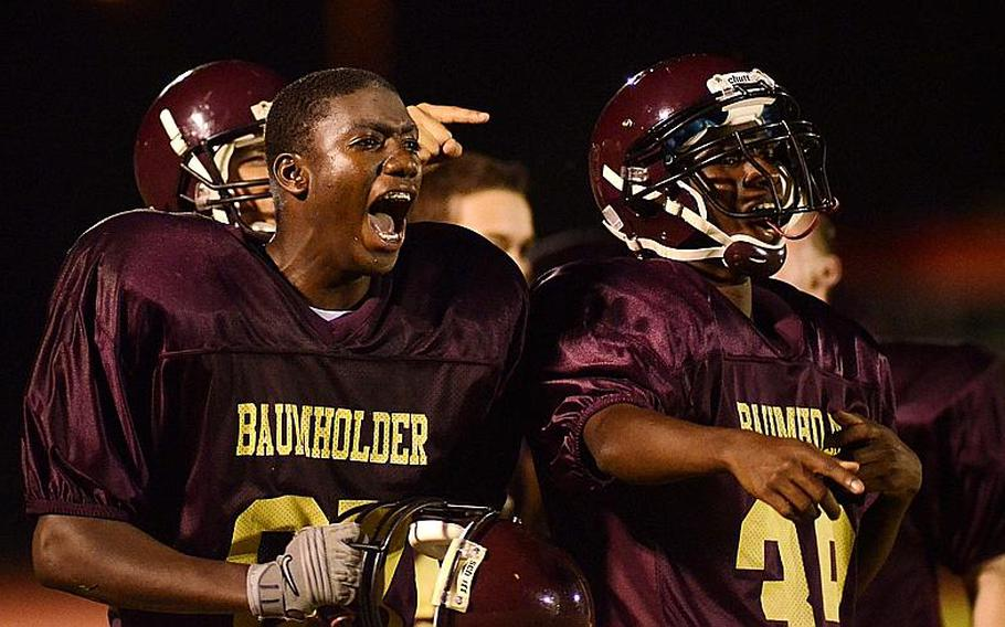 Dasante Browne, left, and Kamryn Wilson, of Baumholder react after a teammate scored a touchdown Friday night at  Baumholder, Germany.