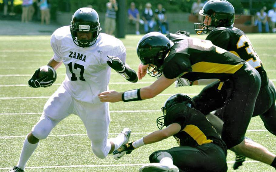 Zama American Trojans running back Mitchell Harrison tries to elude three American School In Japan defenders during Saturday's Kanto Plain Association of Secondary Schools football game in Tokyo. ASIJ rallied from a 20-14 deficit to beat the Trojans 42-26.