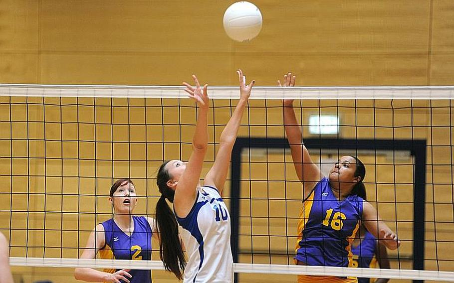 Wiesbaden's Andrea Arnold, center, and Schweinfurt's Chealsea Sias battle at the net as Brigitte Keene watches at left. Wiesbaden won two games against Schweinfurt 25-13, 25-15, in a 35-minute match at a jamboree in Wiesbaden on Saturday. It was the first match for Schweinfurt, a new DODDS school.