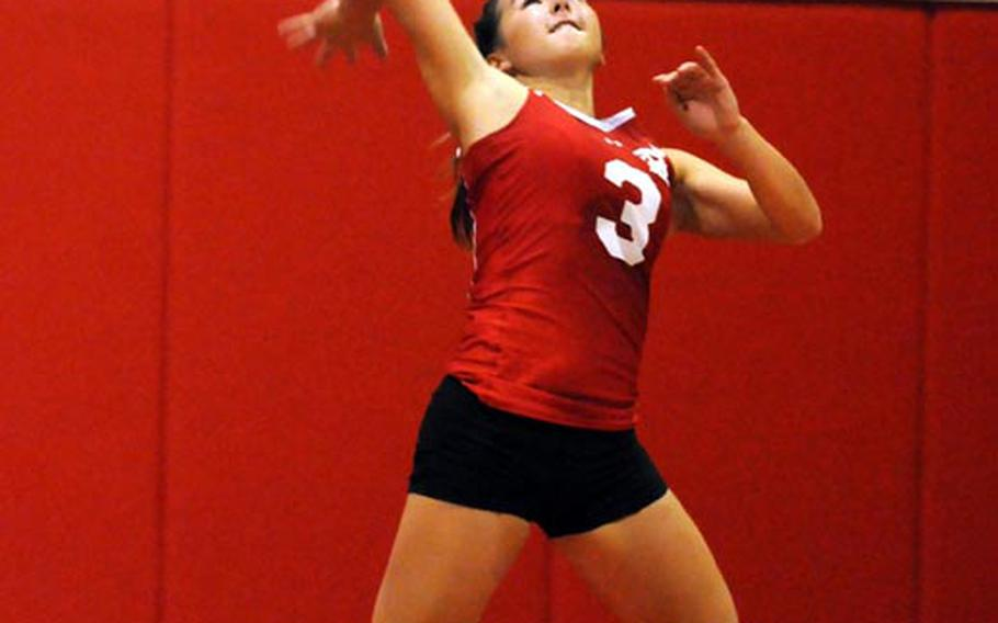 Nile C. Kinnick Red Devils sophomore backliner Kaile Johnson launches a jump serve against the Zama American Trojans during Saturday's DODDS Japan three-way series at Nile C. Kinnick High School, Japan. Kinnick won 25-9, 25-7, 25-15 to stretch its regular-season winning streak to 63 straight dating back to the start of the 2009 season.
