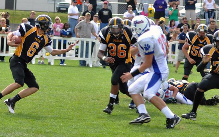 Patch quarterback LeMay Austin decides to run after a quick search for an open reciever Saturday against visiting team Ramstein. Patch beat Ramstein 26 -12.