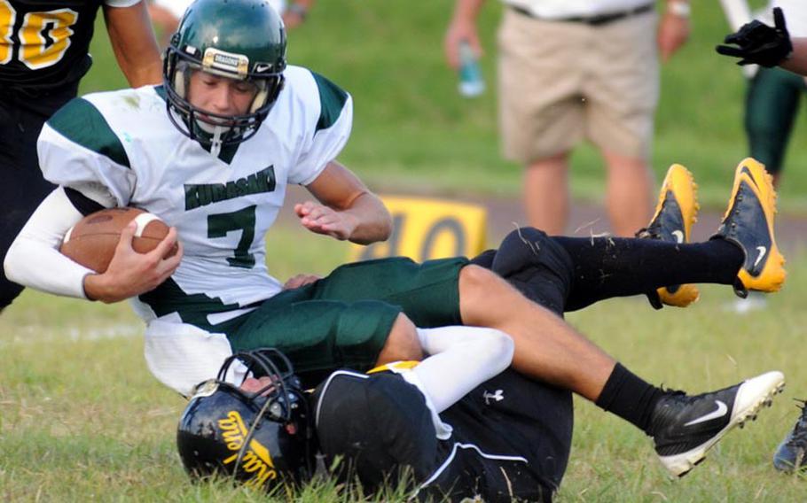 Kubasaki Dragons quarterback Cristian Rivera gets dragged down by Kadena Panthers defender Chris McQuillan during Friday's Okinawa Activities Council football game at Kadena High School, Okinawa.