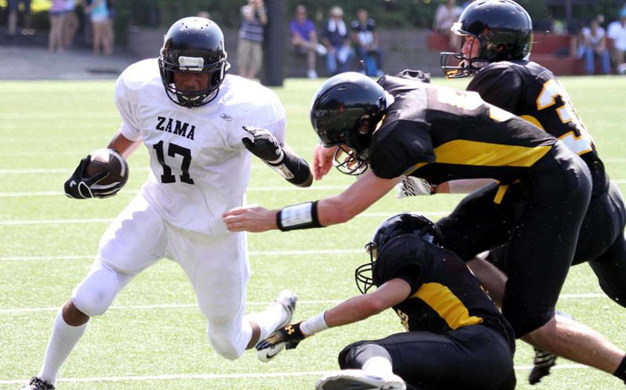 Zama American Trojans sophomore running back Mitchell Harrison, shown here in a game from earlier this season, ran for 228 yards and two touchdowns on 15 carries in Saturday's 42-26 home victory over Osan American.