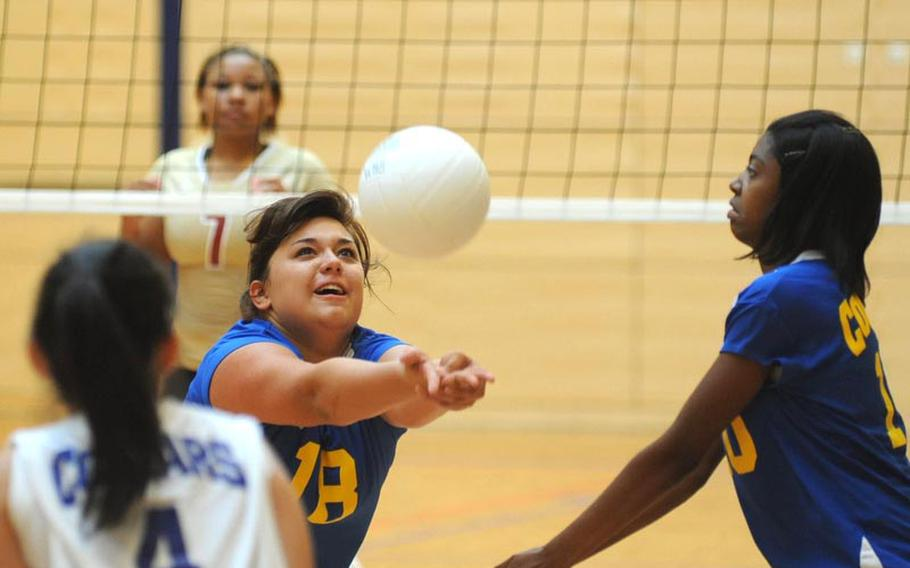 Ansbach's Alyssa Solis bumps the ball in front of teammates Princess Chia, left, and Chealsy Reaves. Division II Ansbach lost their match against defending D I champion Vilseck 18-25, 13-25, 18-25, in Wiesbaden on Saturday.
