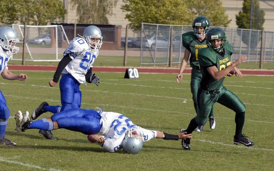 Alconbury running back Vincent Lanphear, a junior, evades outstretched Brussels defender Zack Jackson, a senior, on his way to a sizeable gain Saturday, at RAF Alconbury in England.