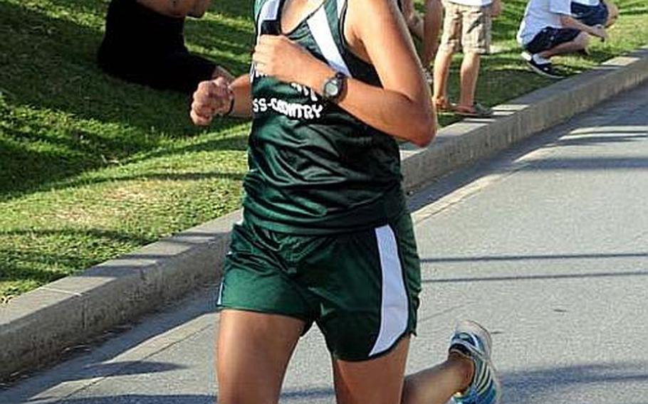 Kubasaki Dragons sophomore cross country runner Alle Robles pushes for the finish line during Wednesday's Okinawa Activities Council's fourth cross-country meet of the season at Camp Foster, Okinawa. Robles won 21 minutes, 29 seconds, her fastest time of the season.