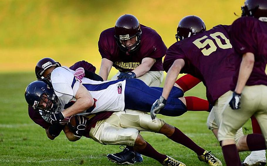 Bitburg running back Kyle Edgar, is tackled by Baumholder's Ben McDaniels.