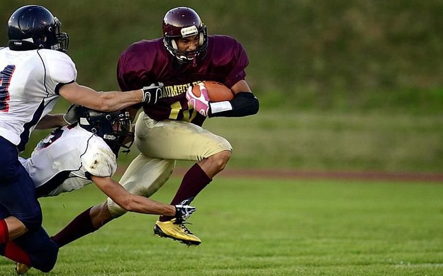 Baumholder's Ben McDaniels breaks a tackle during a 40-14 loss to Bitburg.