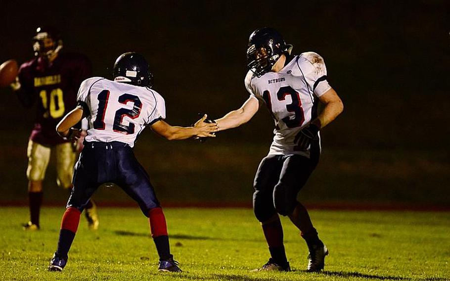 Kyle Edgar celebrates with Corey Bashon after scoring a touchdown Friday night in the Bitburg Barons' 40-14 win against the Baumholder Buccaneers.