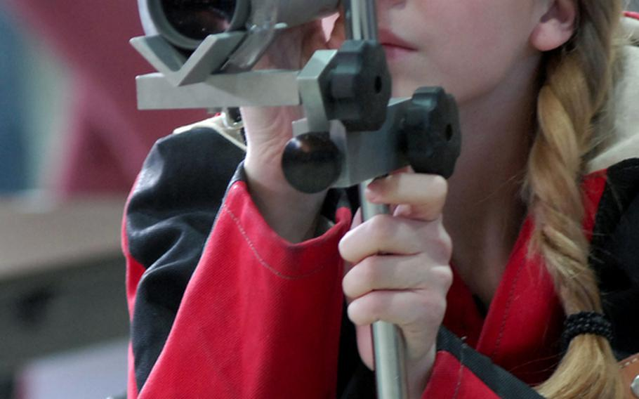 Patch's Mercedes Romih checks where her shots landed during the 2011 DODDS-Europe marksmanship championships at Baumholder, Germany, last season. Romih will be returning for the Panthers when the 2011-12 season gets underway Saturday.