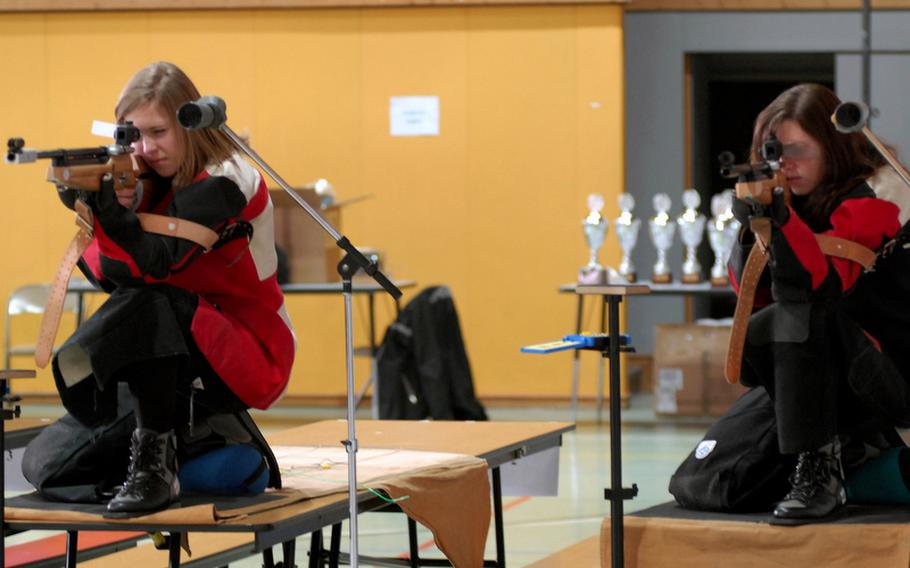 Vilseck's Malia Carson, left, and Christy Chanin get their precision air rifles adjusted before taking aim at last season's DODDS-Europe marksmanship championships at Baumholder High School. Both will be returning for the Falcons when the 2011-12 season gets under way Saturday.