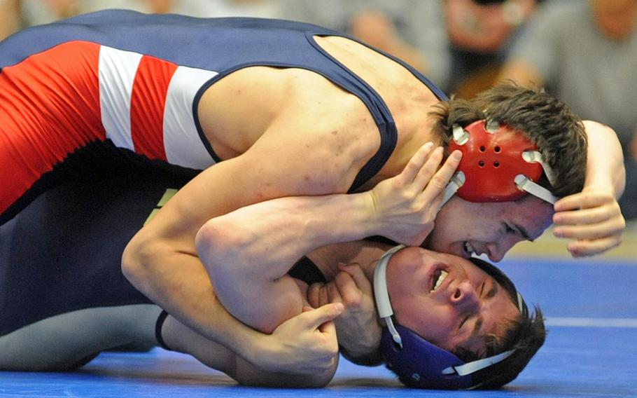 Adam Carroll of Lakenheath, top, beat Heidelberg's Daniel LeJeune for the 145-pound title at last season's championships. Both will be returning when the DODDS-Europe wrestling season gets under way on Saturday.