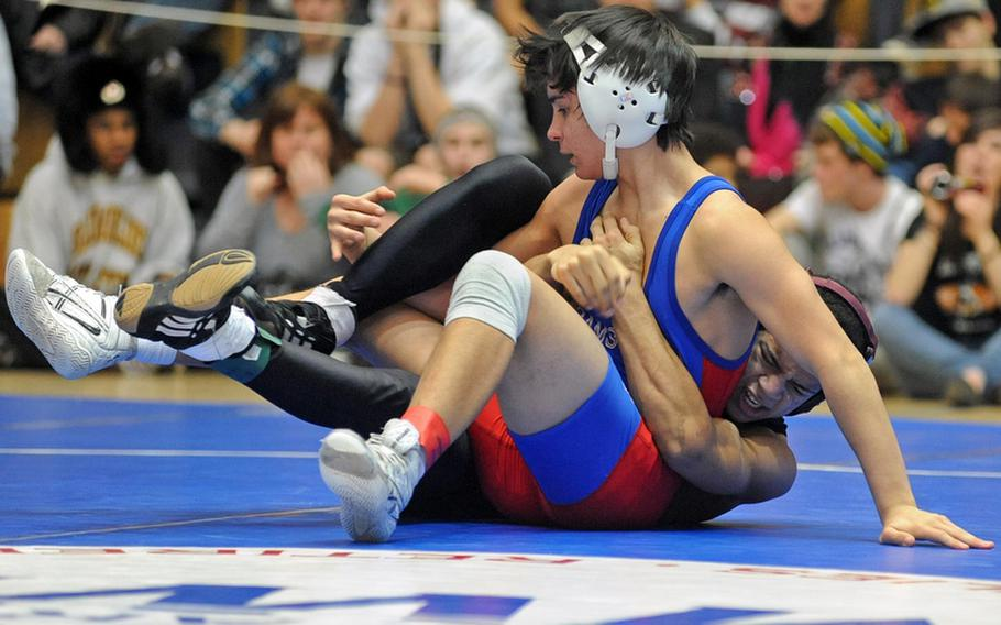 Ramstein's A.J. Franz, left, took the DODDS Europe 119-pound title last season after beating Adrian Julien of Baumholder. Franz will be returning this season for the Royals as the 2011-12 season gets under way Saturday.