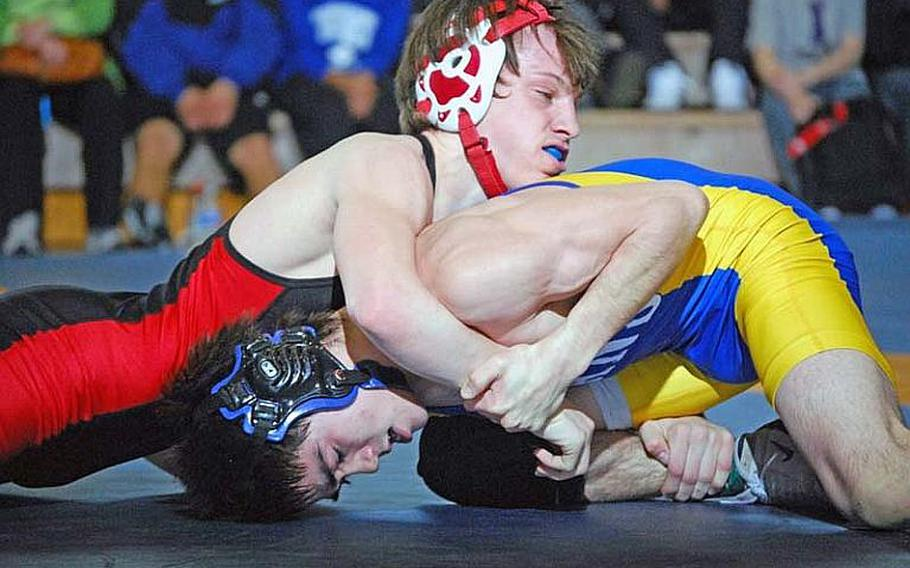 Nile C. Kinnick Red Devils senior Marcus Boehler, top, will wrestle at 135 pounds this season and is trying to become just the third to win four Far East Tournament titles.
