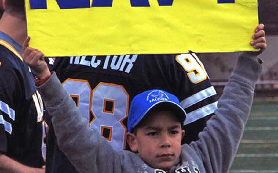 A young fan displays his allegiance during the Army-Navy game Saturday at Seoul American High School.  Army, led by three touchdown passes by quarterback Jeremy Finney, won the game 30-0.