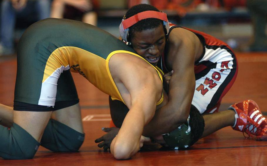 Kaiserslautern's Khadif Williams, a senior, successfully handled an offensive attack on Alconbury freshman Dana Soloman, during a season-opening wrestling match between five DODDS-Europe schools Saturday at RAF Lakenheath, England. Williams won the match by a score of 14-6.