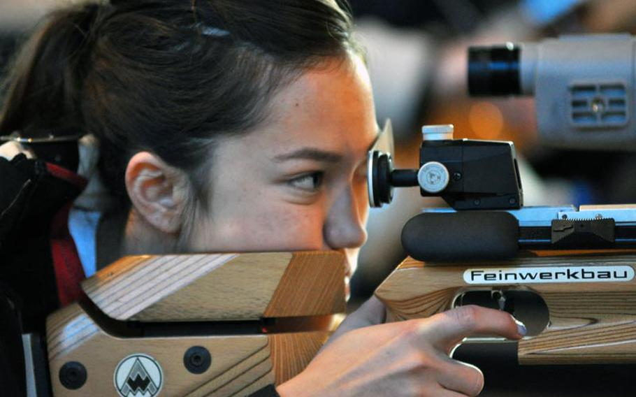 Jennifer Johnson aims in during the first rifle meet of the season Saturday at Patch High School . Johnson tied with Madeline Hershberger for highest individual score at 274. Patch won the event with a score of 1,350.