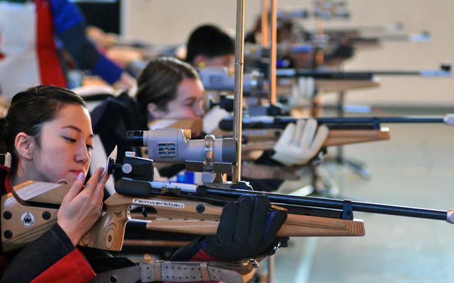 Jennifer Johnson adjusts her rifle during the first rifle meet of the season Saturday at Patch High School. Johnson tied with Madeline Hershberger for highest individual score at 274. Patch won the event with a score of 1,350.