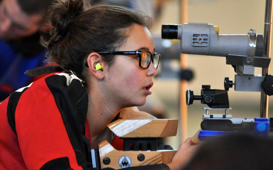 Madeline Hershberger checks her targets during the first rifle team meet of the season Saturday at Patch High School. Hershberger tied with Jennifer Johnson for highest individual score at 274. Patch won the event with a score of 1,350.