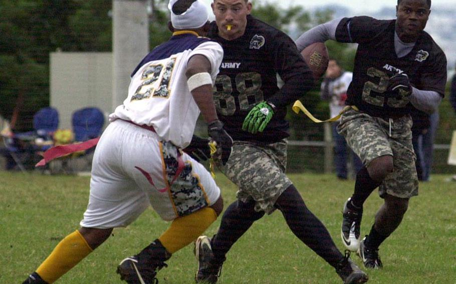 Army running back Joseph Smallwood follows the block of Steven McCleskey against Navy defender Byron Nakamura during Saturday's 22nd Okinawa Army-Navy flag football rivalry game at Torii Field, Okinawa. Army rallied from a 21-12 deficit to beat Navy 25-21.