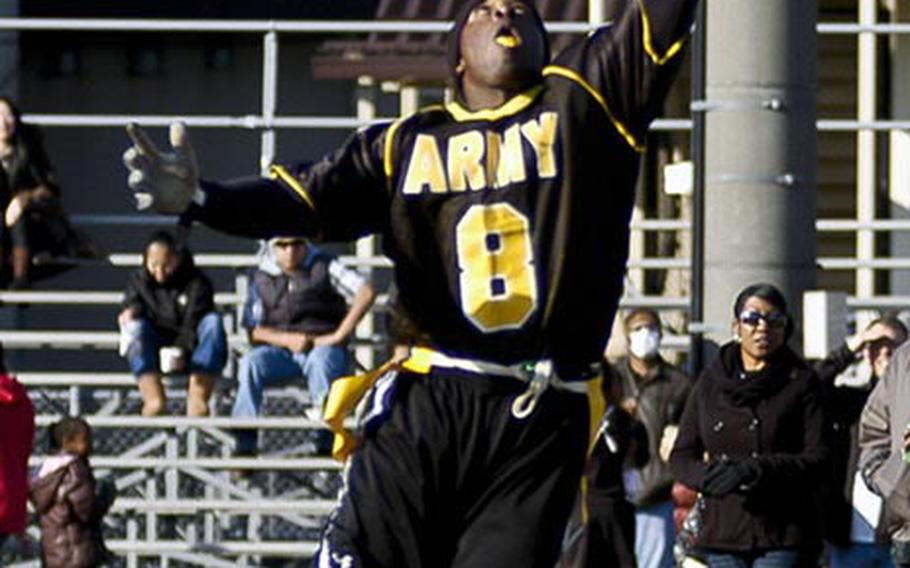 Army's Kelvin Simmons tries to intercept a Navy pass during  Saturday's 10th Japan Army-Navy flag football game at Zama American High School, Japan. Army won 19-7, its second straight win, tying the series 5-5.