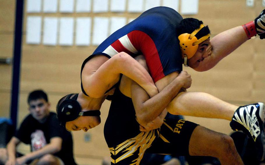 Patch senior Thomas Trevino gets Lakenheath freshman Nelson Arroyo in the air before bringing him to the mat on Saturday at a wrestling tournament at Wiesbaden High School.