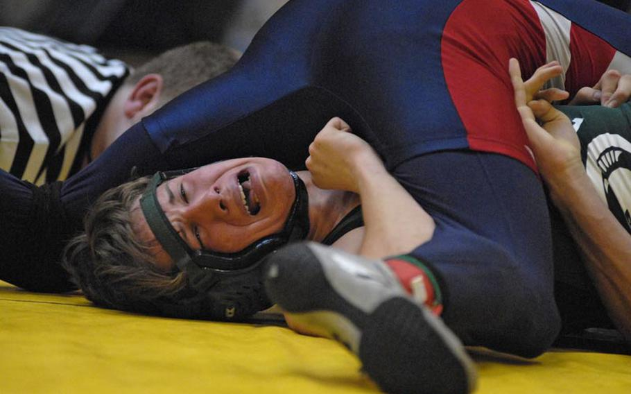 SHAPE's Jacob Stoffer tries to get out from underneath Lakenheath's Devon Parrish in a semifinal 152-pound match during a tournament at Wiesbaden High School.