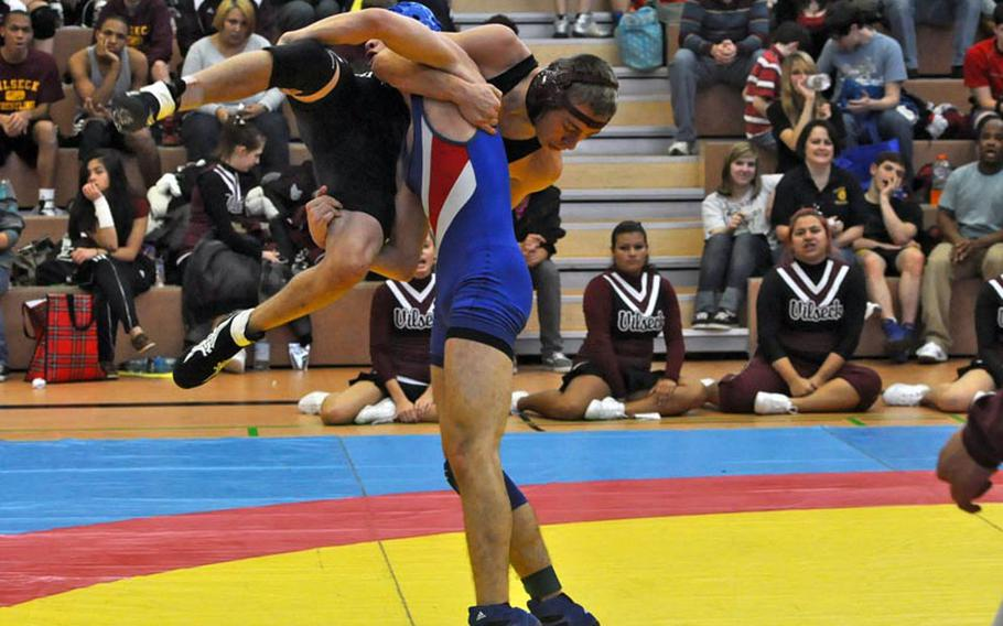 Ramstein sophomore T.J. Moore attempts to slam Jeremy Sullivan, a senior from Vilseck in a 132-ound bout. Sullivan went on to win the match by decision 16-15.