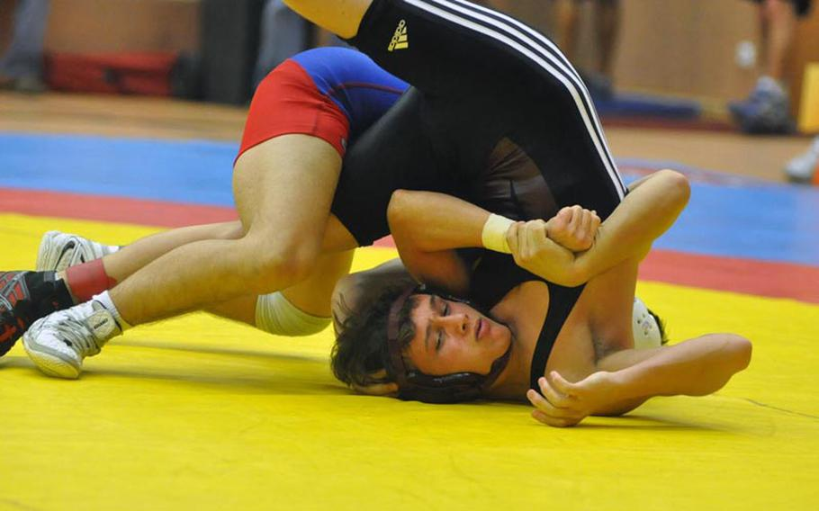 Senior Zachary Rogers of Vilseck is pinned by Ramstein's Adam Franz, also a senior,  in the championship bout of the 126-pound weight class Saturday in Vilseck, Germany.