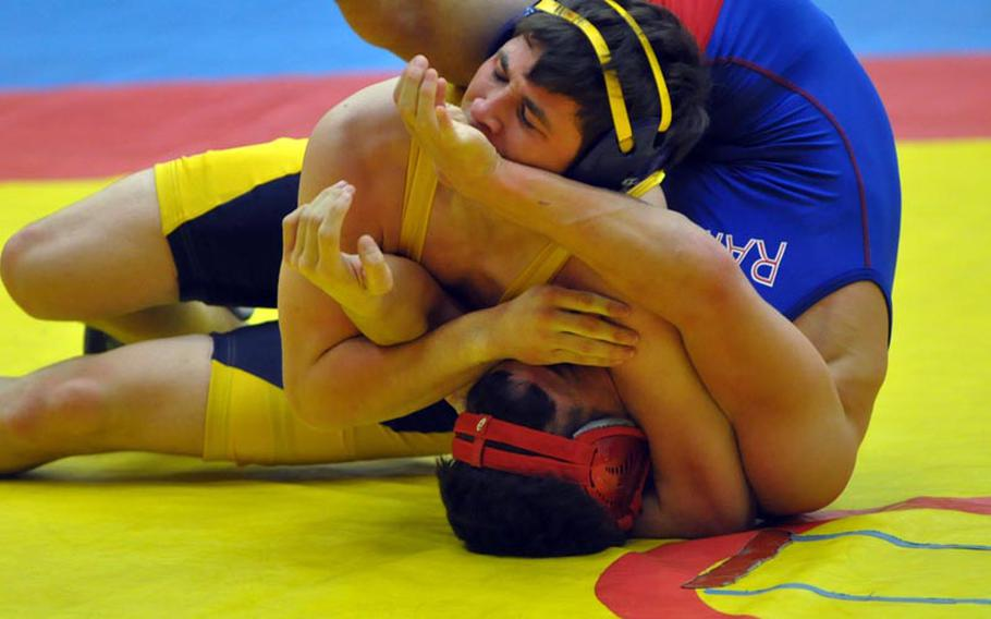 Heidelberg's Daniel LeJeune pins Ramstein's Brandon Furtado in the championship bout of the 145-pound weight class Saturday in Vilseck, Germany.