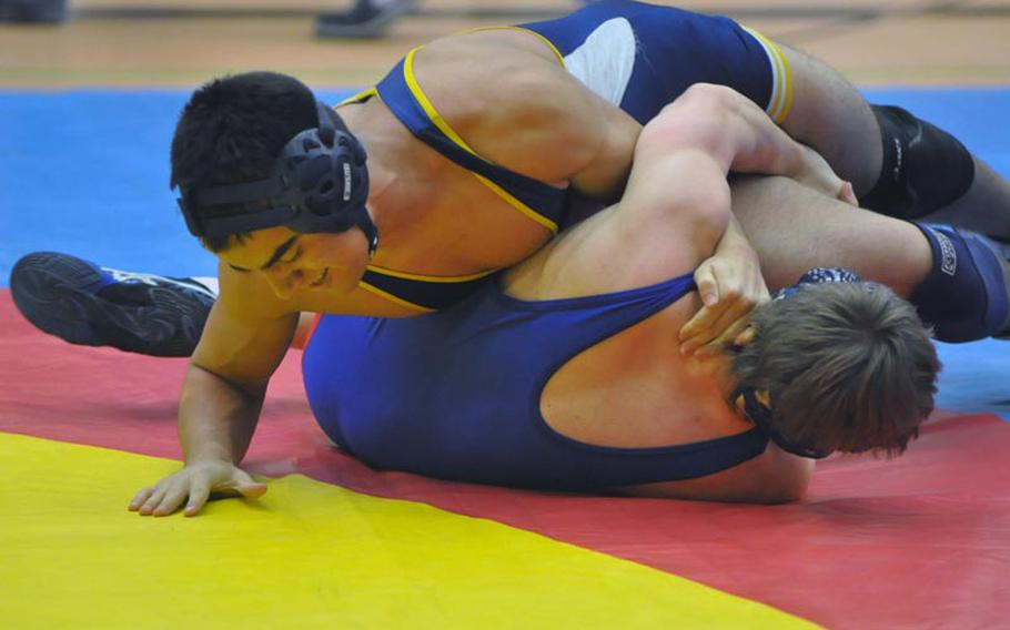 Heidelberg's Jimmie McBride pins Ramstein's Nick Bradley in the championship bout of the 160-pound weight class Saturday in Vilseck, Germany.