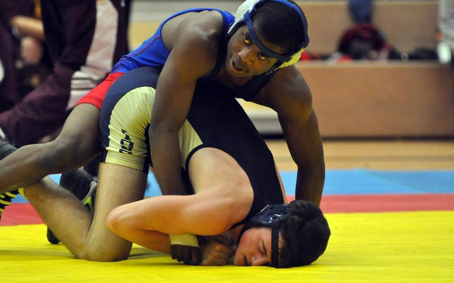 Ramstein's Eric Carter attempts to take the advantage against Heidelberg's Samual Nevinger in the championship bout of the 152-pound weight class Saturday in Vilseck, Germany. Carter went on to win the bout by decision.