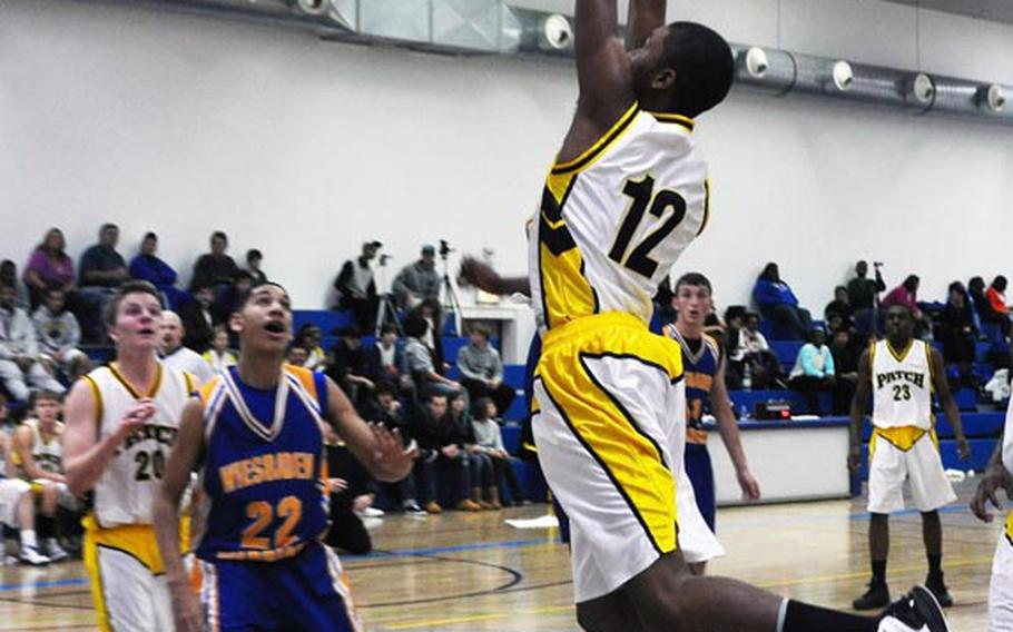 Patch's Keis German leaps for the basket during a game Saturday against Wiesbaden. Patch won 50-41.