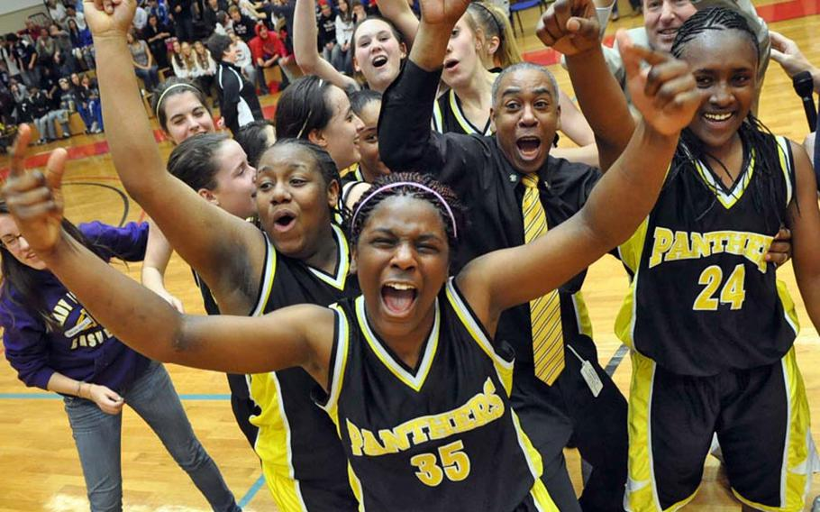 The Patch Lady Panthers celebrate their 64-52 victory over Vilseck in the DODDS Europe Division I girls basketball championship game in February. Teams wearing Panther yellow-and-black won seven of the 17 European Division I championships offered this calendar year. In cross country, baseball and softball, Patch athletes completed the gender-double, winning both the boys' and girls' titles in each. Patch also topped girls' basketball and soccer, wrestling and boys' singles tennis.