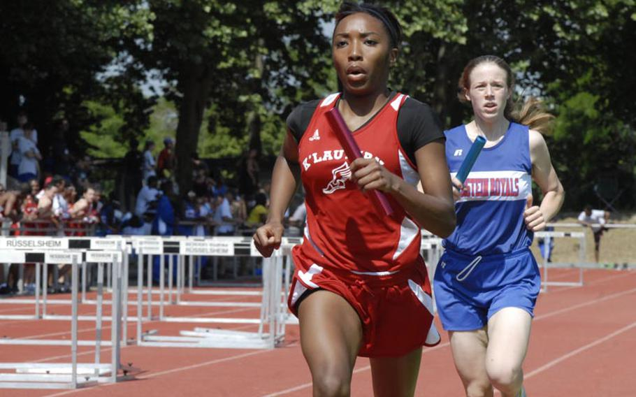 Kaiserslautern's Ashley Santos holds off Ramstein's Anna Priddy during the girls 4x800 meter relay at the 2011 DODDS-Europe Track and Field Championships.  The Kaiserlautern team of Colleen Davis, Ruby Plummer, Rio Harris and Santos broke a DODDS-Europe record in the event with a time of 9:55.02.