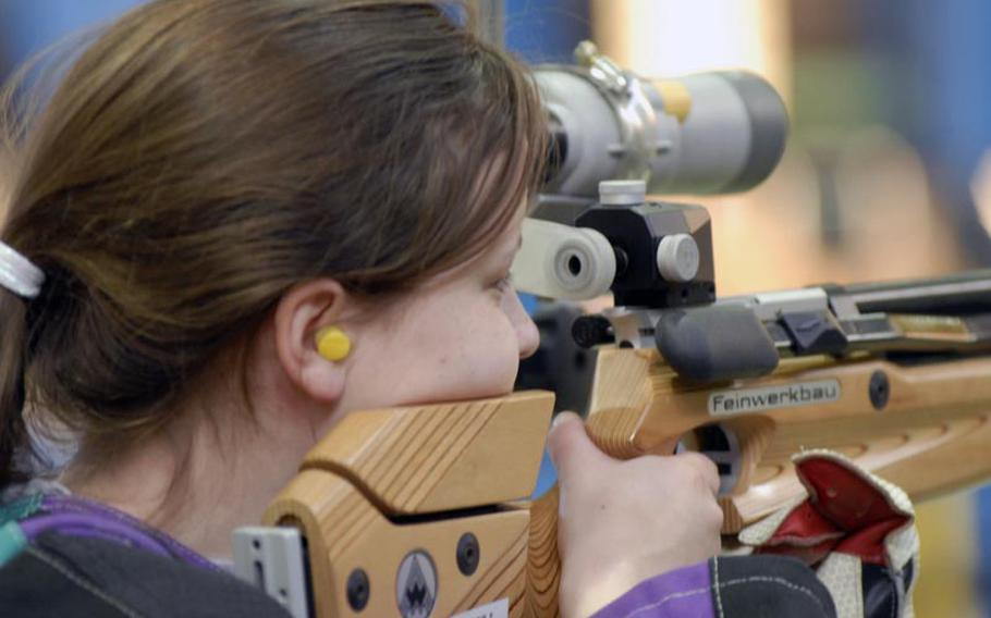 Heidelberg senior Katelyn Bronell takes aim at the 2011 DODDS-Europe marksmanship championships at Baumholder High School in January.  Bronell led all shooters with 281 points.