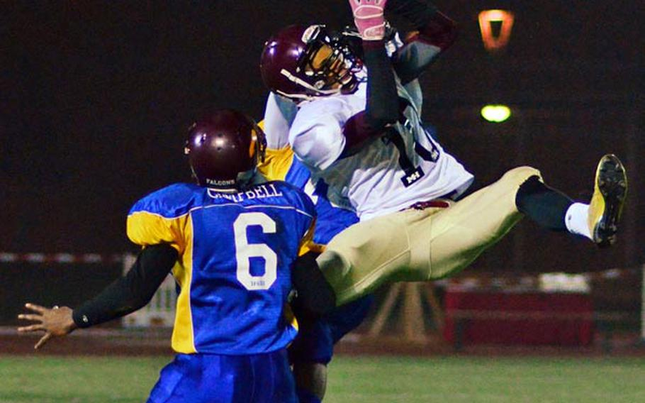 Ben McDaniels of the Nouth All Star Squad makes an athletic attempt to pull down a pass in the DODDS-Europe high school football all star game in November.