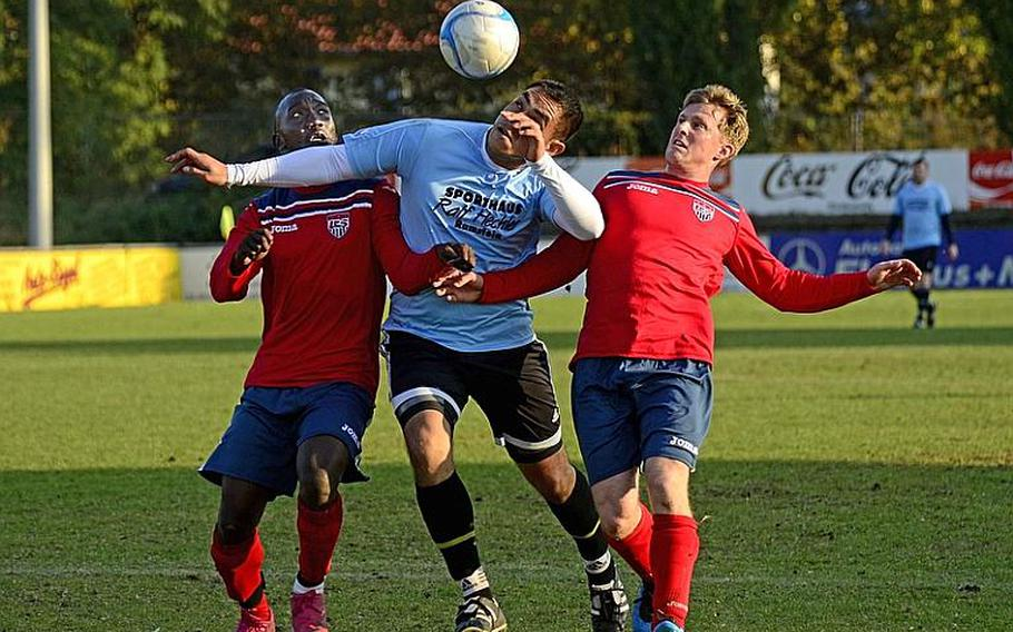 Ramstein's Homero Morales-Arellano splits Vicenza's Abdul Sadiq, left, and Bradley Byington at the 2011 U.S. Forces Europe soccer championship match on Oct. 23.
