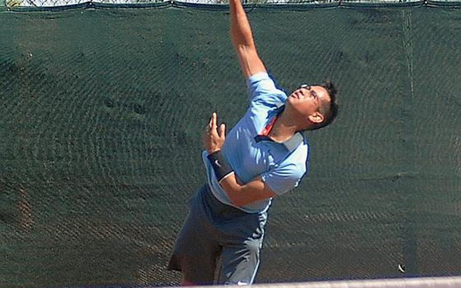 Phillip Ramil hits a serve during his three-set victory Jul. 16, over Brian Kelley in the final match of the U.S. Forces Europe Tennis Championships in Heidelberg, Germany.