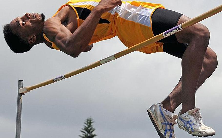 Kadena senior Lotty Smith clears the bar at 2.0066 meters, or a Pacific-record 6 feet, 7 inches, in the high jump finals during the 2011 Far East High School Track and Field Meet at Kubasaki High School, Okinawa. Smith beat his own Pacific record of 1.98 meters and his Far East meet record of 1.92 as Kadena swept the boys, girls and combined teams titles.