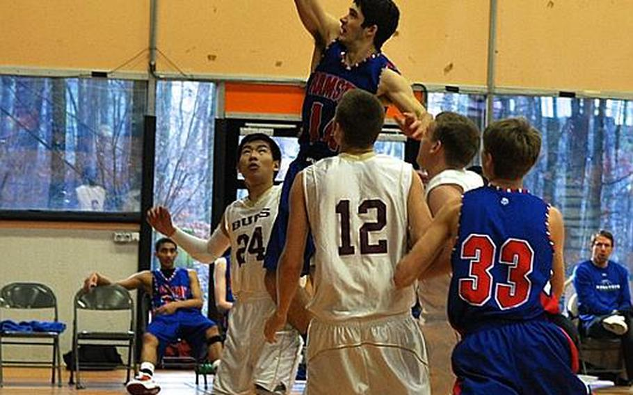 Ramstein's Steven Groenheim rises above his Baumholder opponents to sink his shot Wednesday during a three-day tournament hosted by Patch High School. Ramstein won to move on to the semifinals.