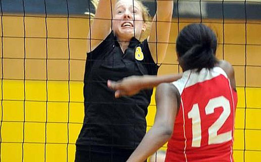 Coaches of 15 Far East Girls Division I Volleyball Tournament teams must figure out how to buckle down and stop junior Liz Thornton, left, reigning tournament Most Valuable Player of reigning champion American School In Japan.