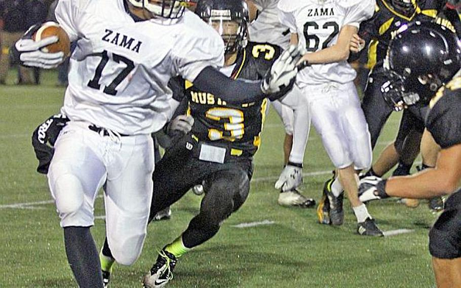 Zama American running back Mitchell Harrison looks for running room against American School In Japan  defense during Friday's Kanto Plain Association of Secondary Schools football game in Tokyo. ASIJ came back from a 19-7 deficit to win 20-19.