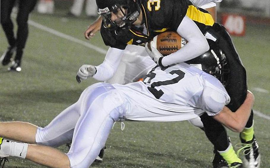 American School In Japan ball carrier Ken Yajima is brought down by Zama American defender Kalob Gunn during Friday's Kanto Plain Association of Secondary Schools football game in Tokyo. ASIJ came from behind 19-7 to win 20-19.
