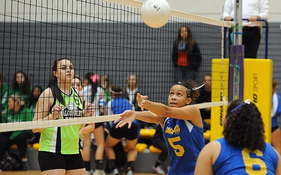 Sigonella's Deeanna Brown set the ball as teammate Dinayda Garcia-Diaz and Alconbury's Hailey Sorensen watch. Sigonella won the match 25-20, 25-23, 22-25, 23-25, 15-13 and will face Rota for the title.