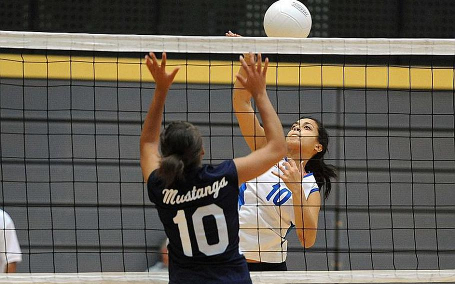 Rota's Natalia Rivera knocks the ball over the net against Menwith Hill's Arielle Rogers. Rota won the Division III semifinal 25-17, 25-15, 25-15 and will face Sigonella in Saturday's final.
