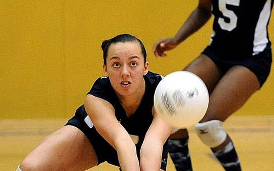 Menwith Hill's Kaia Pierce digs deep to return a Rota serve in a Division III semifinal match at the DODDS-Europe volleyball championships. Rota won 25-17, 25-15, 25-15 and will face Sigonella  in Saturday's final.