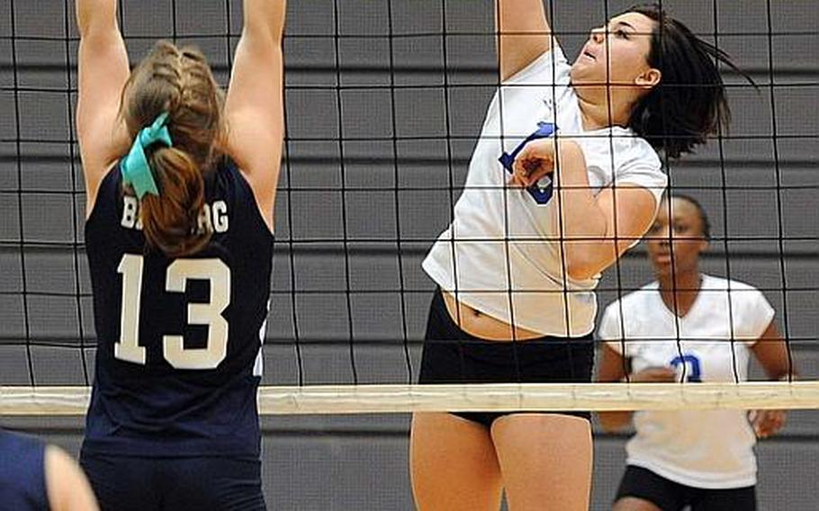 Ansbach's Alyssa Solis hits a ball across the net against Bitburg's Brandy Oliver in a Division II semifinal at the DODDS-Europe volleyball finals. Ansbach won the match 25-13, 25-17, 25-21.